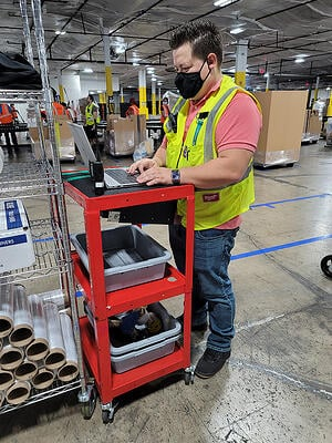 Gabriel Valdivieso, the 2nd Shift Supervisor working on the warehouse floor.