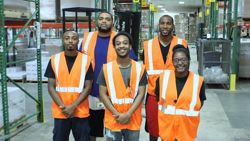 Team members inside of a storage warehouse.