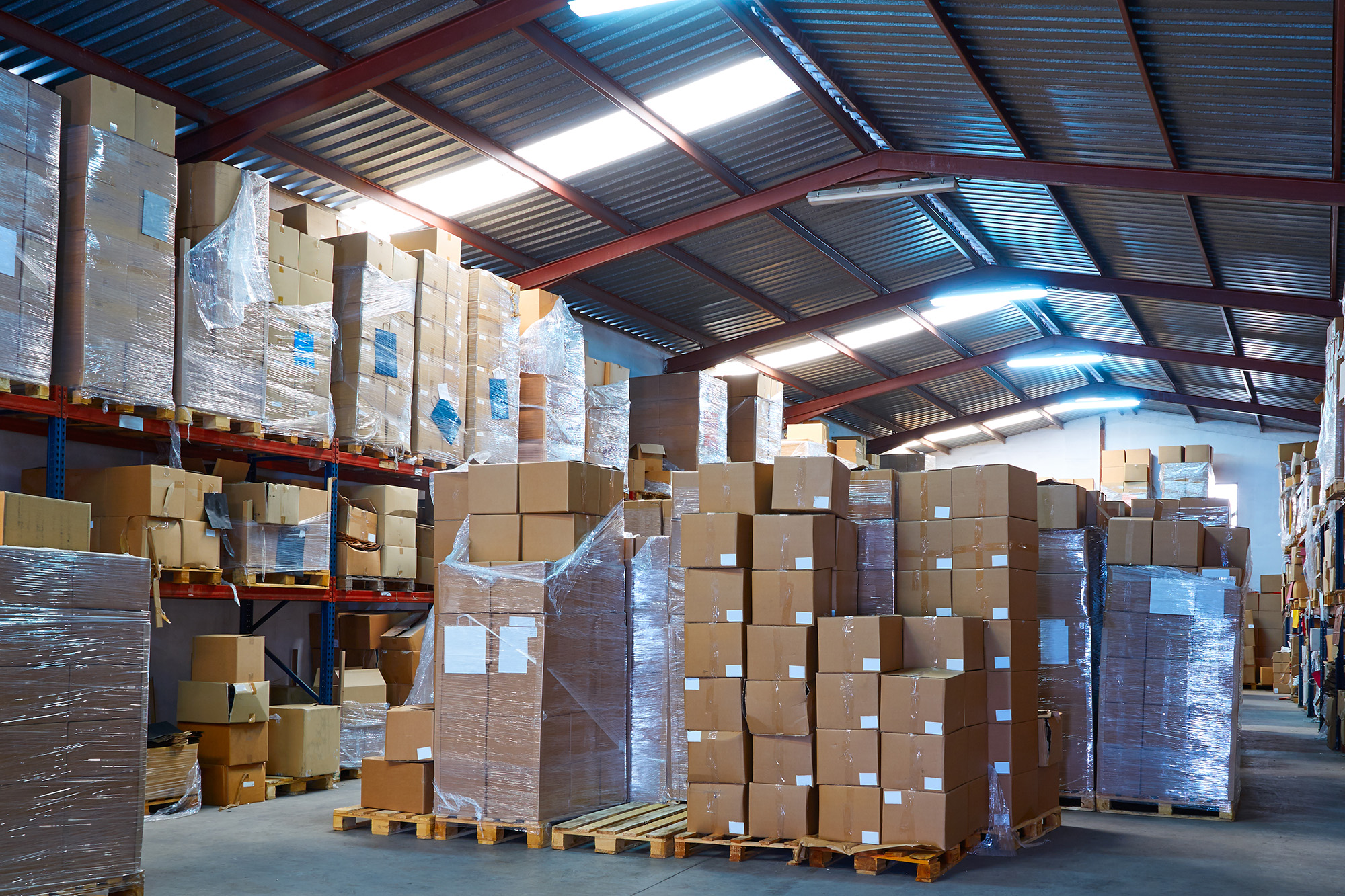 Stacks of boxes inside of a storage warehouse.